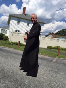 Fr. Finelli gets assaulted with water balloons.