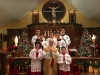 A picture with the servers following Midnight Mass